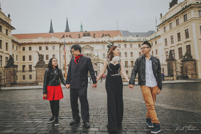 family walking hand in hand Prague Castle