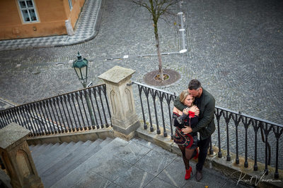 cuddling at the Kampa steps - Prague marriage proposal