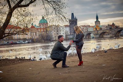 on his knee with the ring - Prague marriage proposal