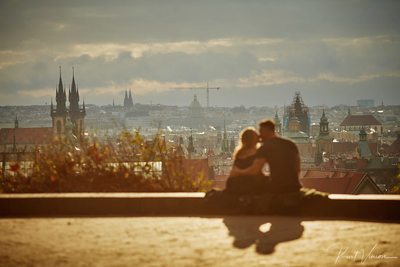 silhouetted against the Prague skyline C&M
