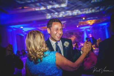Groom dances with a friends Four Seasons Hotel Prague
