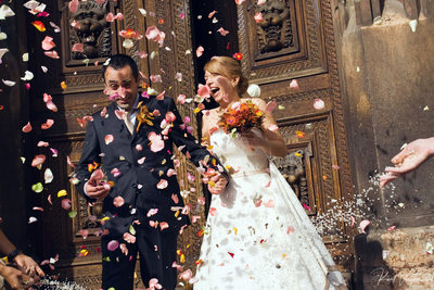 Prague wedding couple showered in rose petals & rice