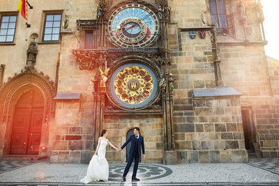 sexy, stylish couple under the Astronomical Clock