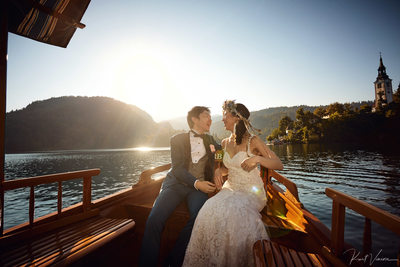 wedding couple enjoying boat ride Lake Bled