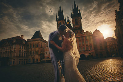pre wedding art Prague Old Town Square kiss under veil