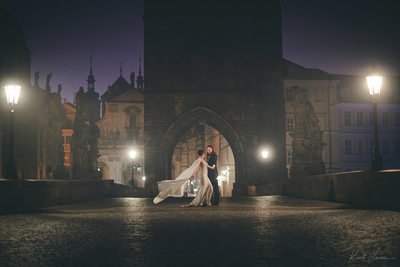 Gorgeous couple night time Charles Bridge Berta dress
