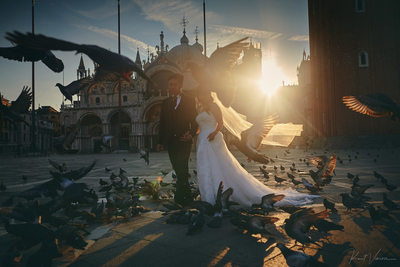 bride & groom walking in Piazza San Marco at sunrise