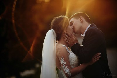 Golden Hour kiss for the happy bride & groom