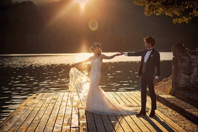 celebrating their wedding in the Golden Light Lake Bled