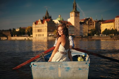 bride & groom in rowboat during golden light hour