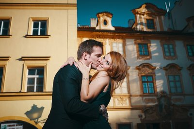 sexy-fun kiss captured at sunset Prague Castle