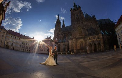 bride & groom walking near St. Vitus Cathedral