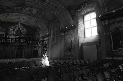bride walking in the light at the Klementinum in Prague