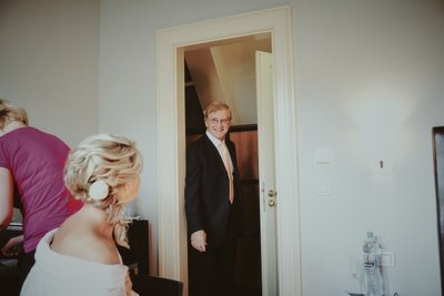 Father of bride checking on daughter on wedding day
