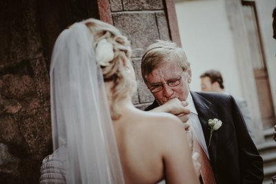 Father kissing his daughters hand