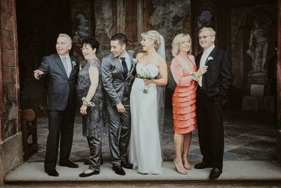 bride & groom and their parents have a laugh