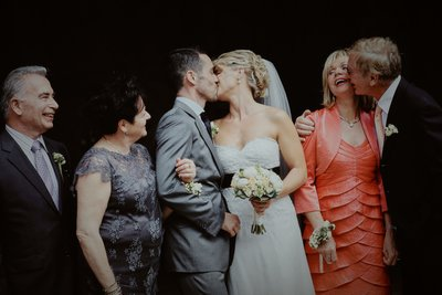 Newlyweds kiss as parents react