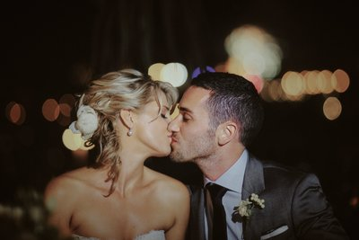 Bride & Groom - kiss as fireworks explode behind them