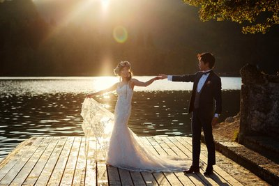 Holding his brides hand  Golden Light of Lake Bled