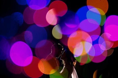Lucia & Cary surrounded by color bokeh balls