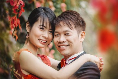 Smiling happy Chinese bride2be & her fiancee in Prague