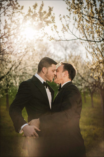 a sun flared kiss for these two gentlemen