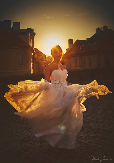dancing in the sun Prague Golden Hour bridal photo