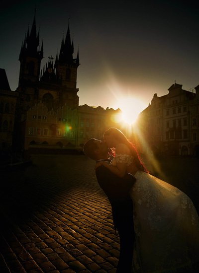 bride & groom experiencing sunrise at Old Town Square