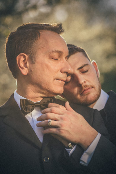 portrait of two men during their engagement session