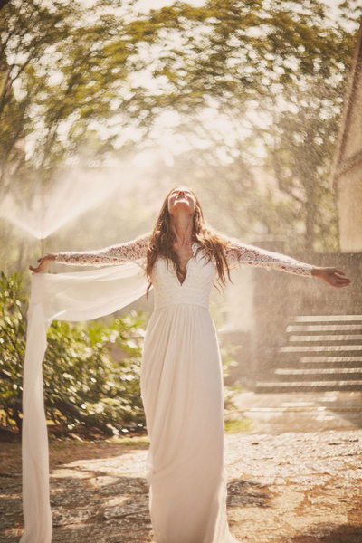 Bride in the Golden Light water sprinkler wedding photo