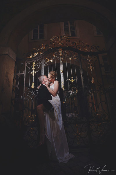 A sexy night time wedding portrait from Prague Castle