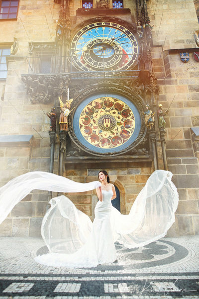 Posing like an angel under Astronomical clock