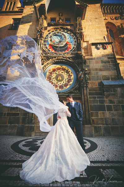 bride & groom underneath the Astronomical Clock