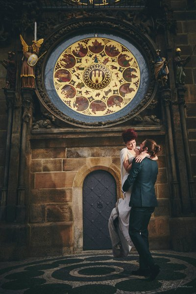 spinning his woman under the Orloj in Prague!