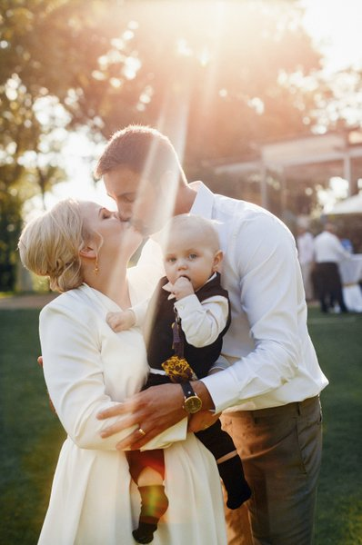 bride, groom and son illuminated by God's Light