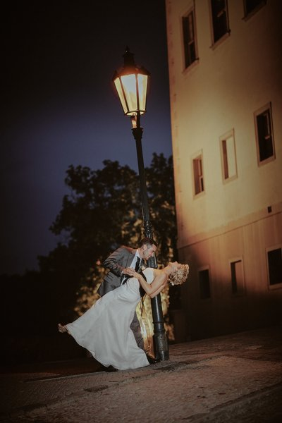 dipping his bride under the gas lamps of Prague Castle