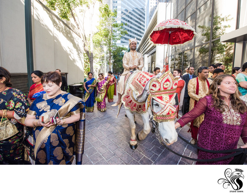 Groom Arrives on horseback at Omni Charlotte Hotel