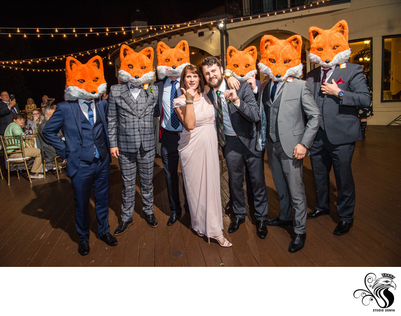 Fun Photo of Groom and Mother with Wedding Guests