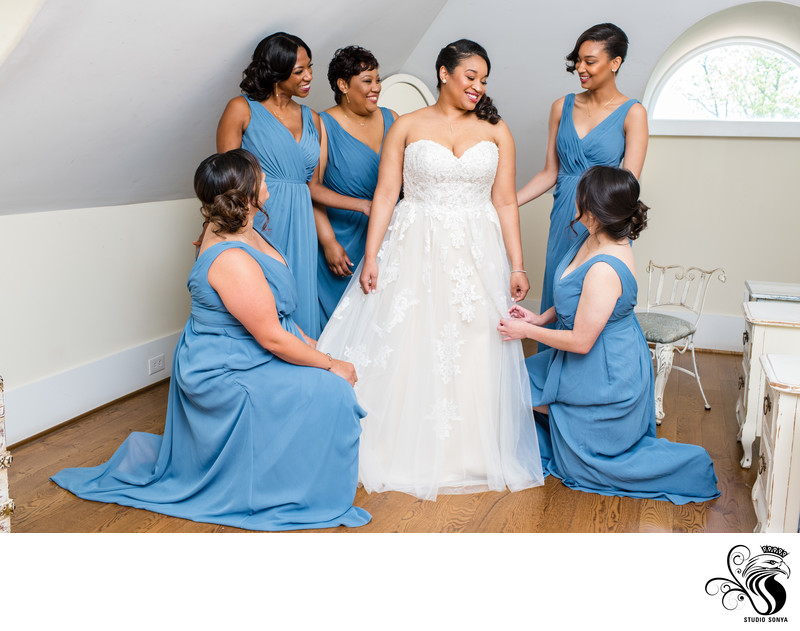 Bridesmaids admiring Bride's Dress