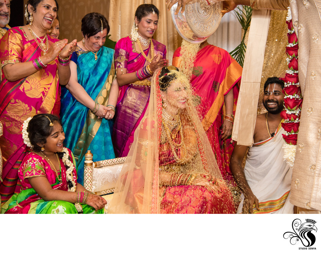 Groom Showering Rice on Bride at Omni Charlotte Hotel
