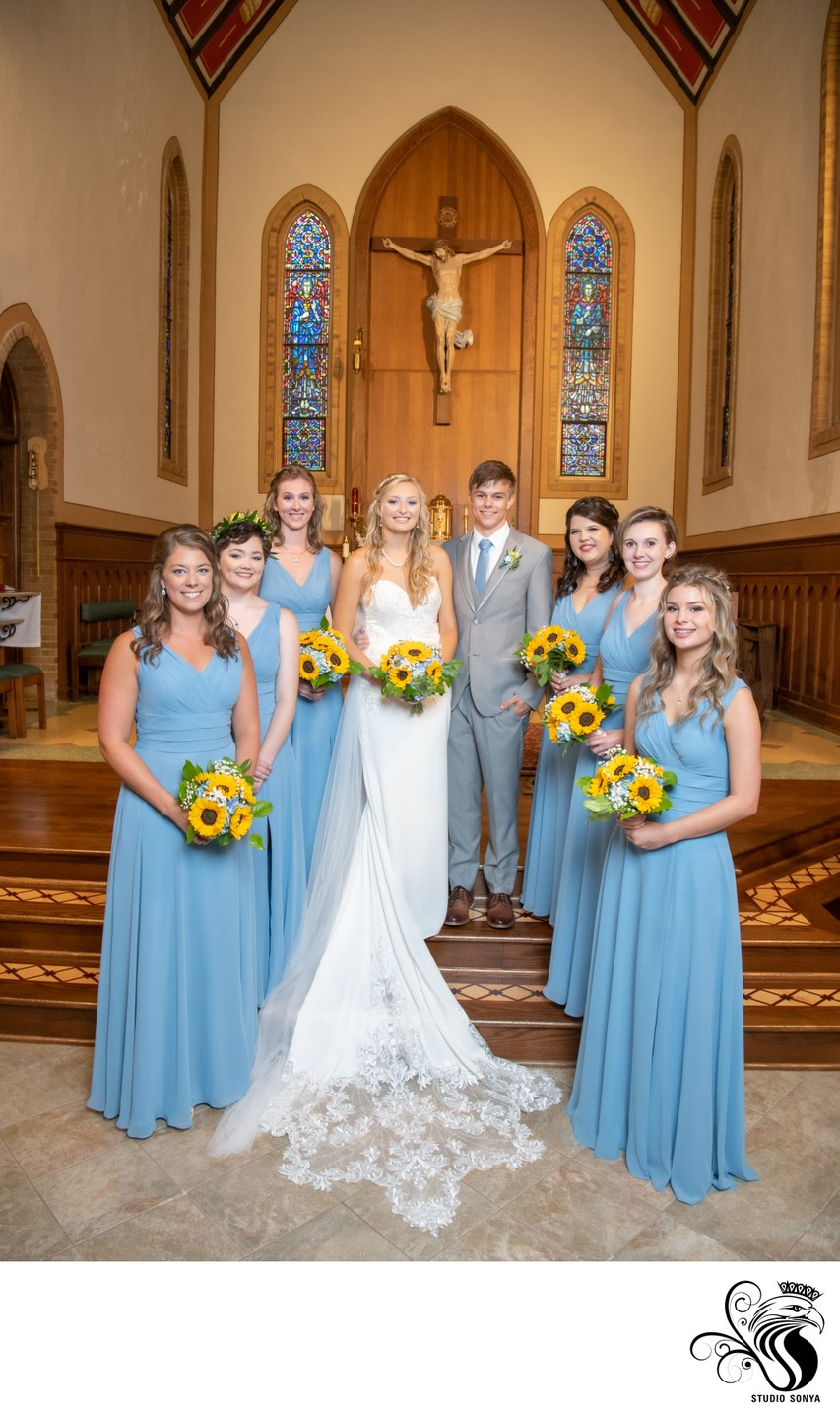 Couple and bridesmaids in front of altar