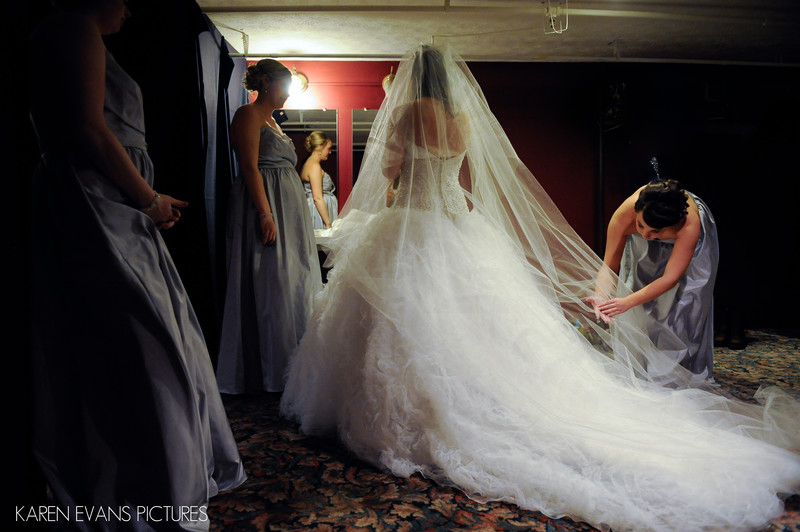 Bridesmaids Helping Bride with Veil