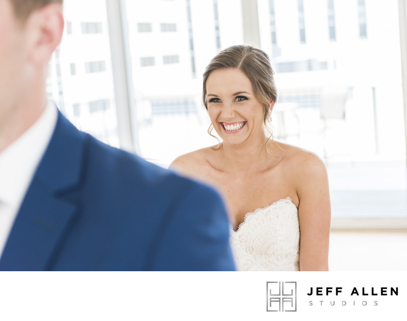 Bride Sneaking Up on Groom During First Look in Raleigh