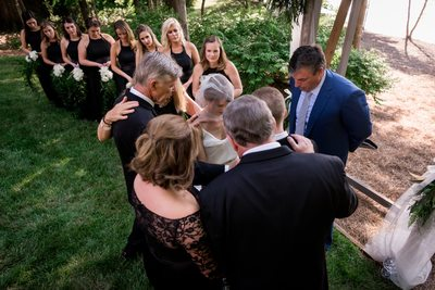 Family Prays Together During Backyard Ceremony