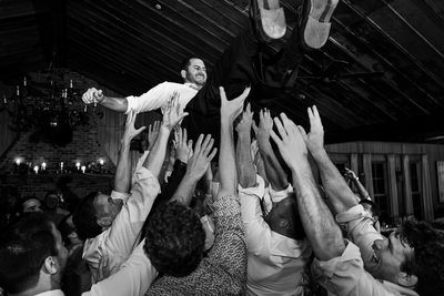 Groom Lifted In Air During Quail Branch Lodge Reception