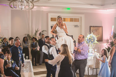 JEWISH WEDDING PHOTOGRAPHY HORA CHAIR DANCE