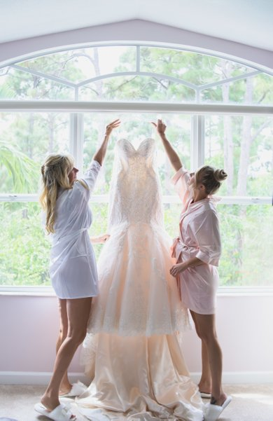 BRIDES WEDDING DRESS AND BALL GOWN