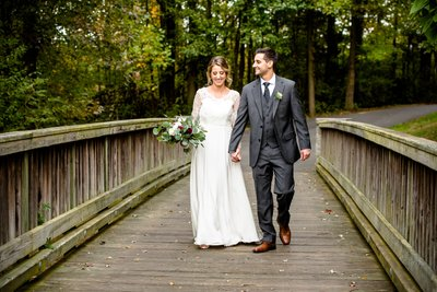 Bride & Groom walking on wooden bridge in South Jersey