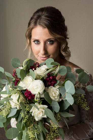 Bride with large leafy bouquet