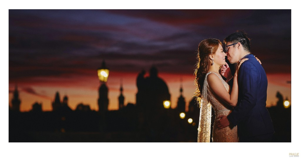 A magical kiss for the bride as the sky flares above